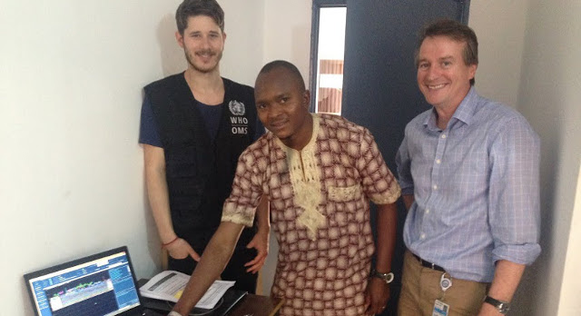 Josh Quick (left) shows his work to colleagues Abubakar Soumah (centre) and Miles Carroll during his stay in Guinea